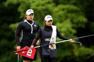 Ariya Jutanugarn with her caddie/sister Moriya Jutanugarn look over their putt at No. 2 during the semifinals at the 112th U. S. Women's Amateur Championship. Jutanugarn lost to New Zealand's Lydia Ko, 3&1.