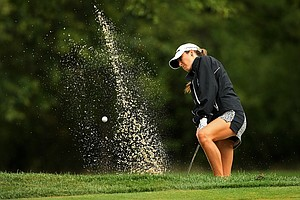 Jaye Marie Green blasts out of the bunker at No. 8 during the semifinals at the 112th U. S. Women's Amateur Championship.