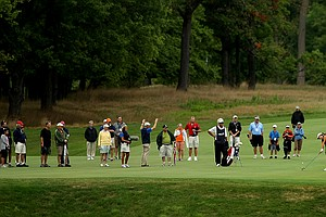 Spectators line the fairway as Jaye Marie Green hits a shot during the semifinals at the 112th U. S. Women's Amateur Championship. Green will meet Lydia Ko in the finals.