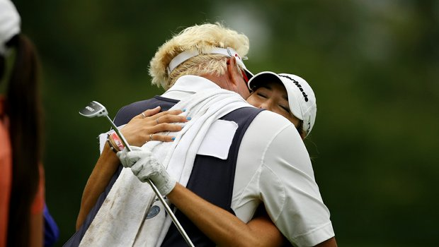 Jaye Marie Green gets a big hug from her dad/caddie, Donnie, after she won her match over Nicole Zhang during the semifinals at the 112th U. S. Women's Amateur Championship.