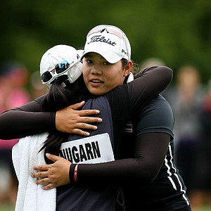 Ariya Jutanugarn hugs her sister, Moriya, after she lost to Lydia Ko during the semifinals at the 112th U. S. Women's Amateur Championship.