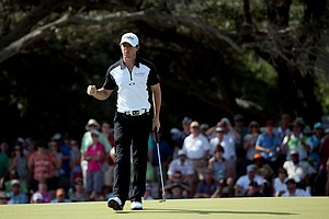 Rory McIlroy reacts after making a birdie putt on the eighth green during Round Three of the 94th PGA Championship at the Ocean Course on August 11, 2012 in Kiawah Island, South Carolina.