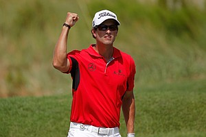 Adam Scott reacts after chipping in on the fifth hole during Round Three of the 94th PGA Championship at the Ocean Course on August 11, 2012 in Kiawah Island, South Carolina.
