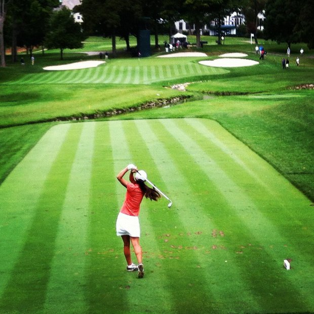 Nicole Zhang hits her tee shot at No. 9 during the semifinals at the 112th U. S. Women's Amateur Championship. Zhang lost to Jaye Marie Green.