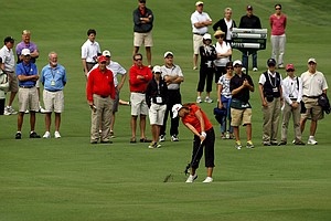 Lydia Ko hits her second shot at No. 15 during the finals at the 112th U. S. Women's Amateur Championship.