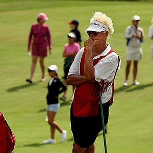 Donnie Green, father and caddie to Jaye Marie Green waits for his daughter during the finals at the 112th U. S. Women's Amateur Championship.