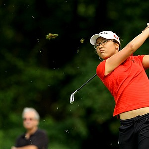 Lydia Ko of New Zealand hits her tee shot at No. 17 during the finals at the 112th U. S. Women's Amateur Championship.