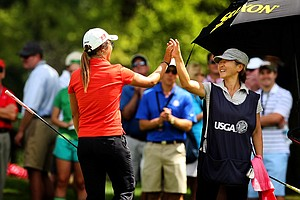 Lydia Ko high fives her mom Tina after holing out at No. 7 during the second round of the finals at the 112th U. S. Women's Amateur Championship.