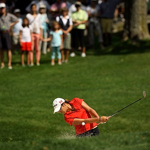 Lydia Ko hits out of the bunker at No. 9 during the second round of the finals at the 112th U. S. Women's Amateur Championship.