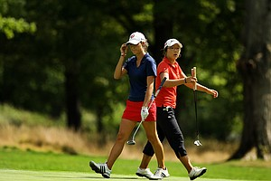 Lydia Ko of New Zealand Jaye Marie Green of Boca Raton, Fla., walks past each other at the 10th green during the second round of the finals at the 112th U. S. Women's Amateur Championship.