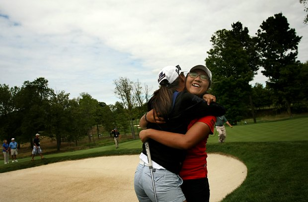 Lydia Ko, right, gets a great big hug from friend and U. S. Girls Junior Champion Minjee Lee, after she defeated Jaye Marie Green at the 112th U. S. Women's Amateur Championship at The Country Club in Cleveland.