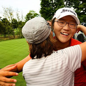 Lydia Ko hugs her mom/caddie Tina after she defeated Jaye Marie Green 3&1 during the finals at the 112th U. S. Women's Amateur Championship at The Country Club in Cleveland.