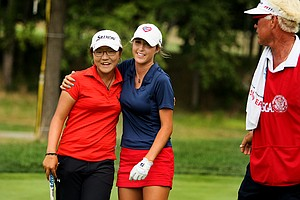 Jaye Marie Green center, hugs Lydia Ko for a second time after Ko won the 112th U. S. Women's Amateur Championship at The Country Club in Cleveland. At right is Green's caddie/dad, Donnie.
