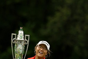 Lydia Ko is surprised by the weight of The Robert Cox Trophy after winning the 112th U. S. Women's Amateur Championship at The Country Club in Cleveland. Ko defeated Jaye Marie Green 3&1.