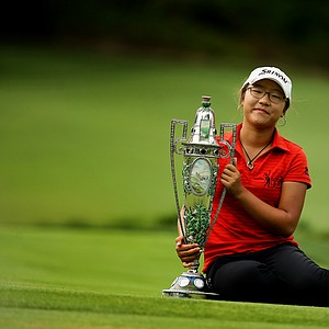 Lydia Ko poses with The Robert Cox Trophy during after the finals at the 112th U. S. Women's Amateur Championship at The Country Club in Cleveland. Ko defeated Jaye Marie Green 3&1.