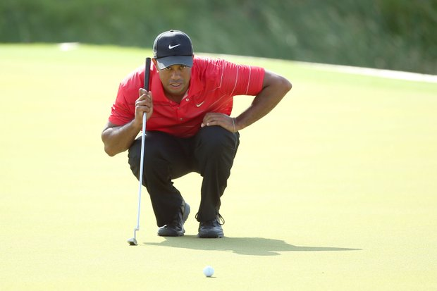 Tiger Woods lines up a putt on the 17th green during the third round of the 94th PGA Championship.