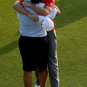 Rory McIlroy hugs his father Gerry McIlroy after winning the 94th PGA Championship at the Ocean Course.