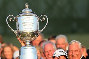 Rory McIlroy holds up the Wanamaker Trophy after winning the 94th PGA Championship at the Ocean Course.