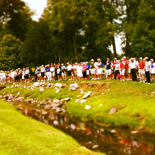 Spectators line the course at No. 1 during the finals at the 112th U. S. Women's Amateur Championship.
