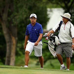 Jim Liu, the 2010 U. S. Junior Champion, walks up No. 18 during the 112th U. S. Amateur Championship at Cherry Hills Country Club.