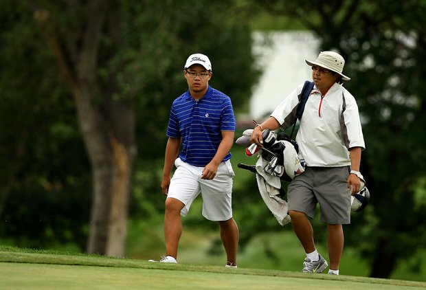 Jim Liu, the 2010 U. S. Junior Champion, walks up No. 18 during the 112th U. S. Amateur Championship at Cherry Hills Country Club.