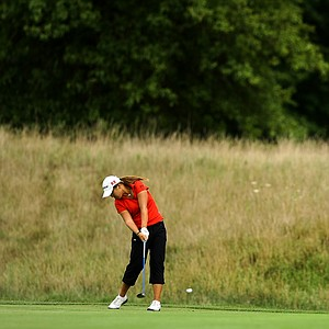 Lydia Ko hits her second shot at No. 12 during the second round of the finals at the 112th U. S. Women's Amateur Championship.