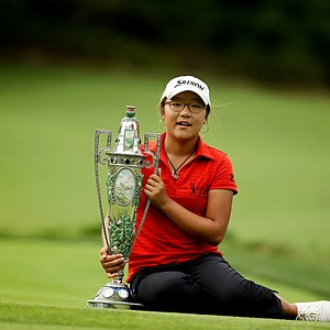 Lydia Ko poses with The Robert Cox Trophy at the 112th U. S. Women's Amateur Championship at The Country Club in Cleveland.