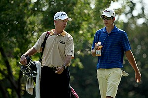 Larry Mize, former Master's winner and current Champions Tour player caddied for his son Robert during the 112th U. S. Amateur Championship.