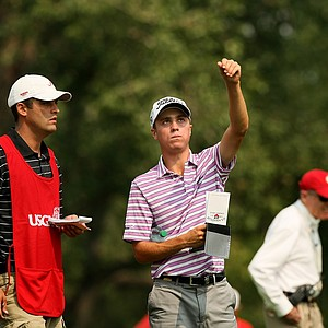 Justin Thomas checks the wind with his caddie Michael Grellar during the Round of 64 at the 112th U. S. Amateur Championship. Thomas advanced to the Round of 32.