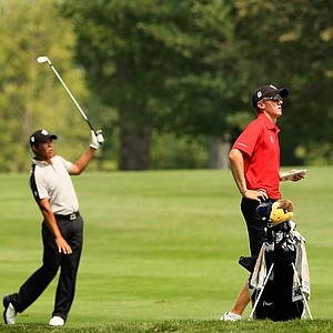 Mackenzie Hughes, right, watches the shot of Albin Choi, left, during the all Canadian match in the Round of 64 at the 112th U. S. Amateur Championship at Cherry Hills. Choi advanced.