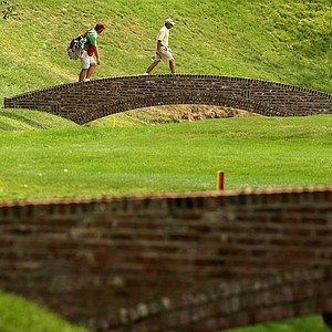 Doug Hanzel, 55, and his caddie Andy Harwood walk across a bridge at No. 16 during the Round of 64 at the 112th U. S. Amateur Championship at Cherry Hills Country Club. Hanzel advanced to the Round of 32.