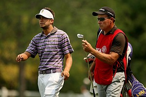 Curtis Thompson with his dad/caddie Scott Thompson during the Round of 64 at the 112th U. S. Amateur Championship. Thompson lost to Edourd Espana.