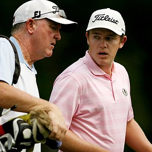 Michael Weaver talks with his dad/caddie Bill Weaver during the Round of 64 at the 112th U. S. Amateur Championship.
