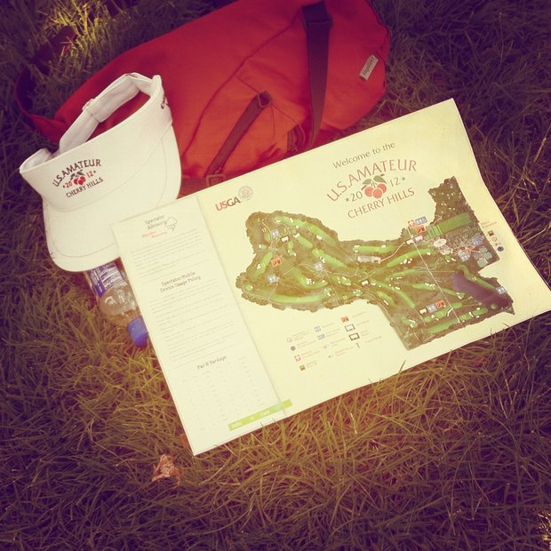 Cherry Hills map and hat lie on the ground during the Round of 64 at the 112th U. S. Amateur Championship at Cherry Hills Country Club in Colorado.