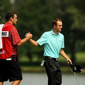 Justin Thomas and his caddie Michael Grellar celebrate their win during the Round of 32 at the 112th U. S. Amateur Championship at Cherry Hills Country Club in Colorado. Thomas defeated Max Homa.