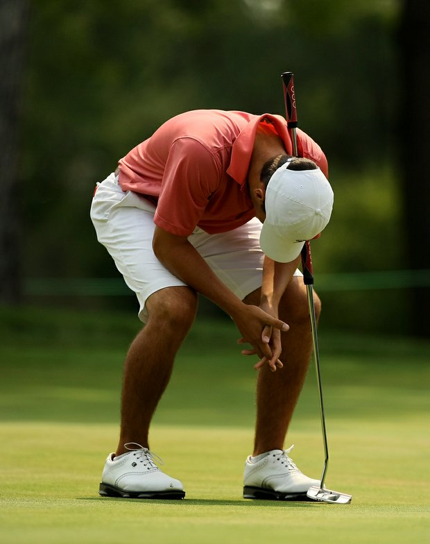 Zach Munroe reacts to missing a putt during the Round of 32 at the 112th U. S. Amateur Championship at Cherry Hills Country Club.
