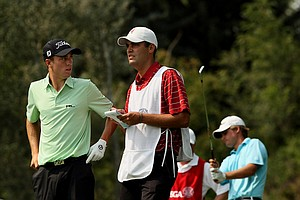 Justin Thomas and his caddie Michael Grellar talk during the Round of 16 at the 112th U. S. Amateur Championship at Cherry Hills Country Club.
