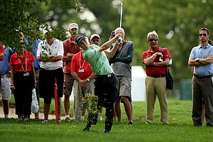 Justin Thomas hits from under a tree at No. 17 during the Round of 16 at the 112th U. S. Amateur Championship at Cherry Hills Country Club.