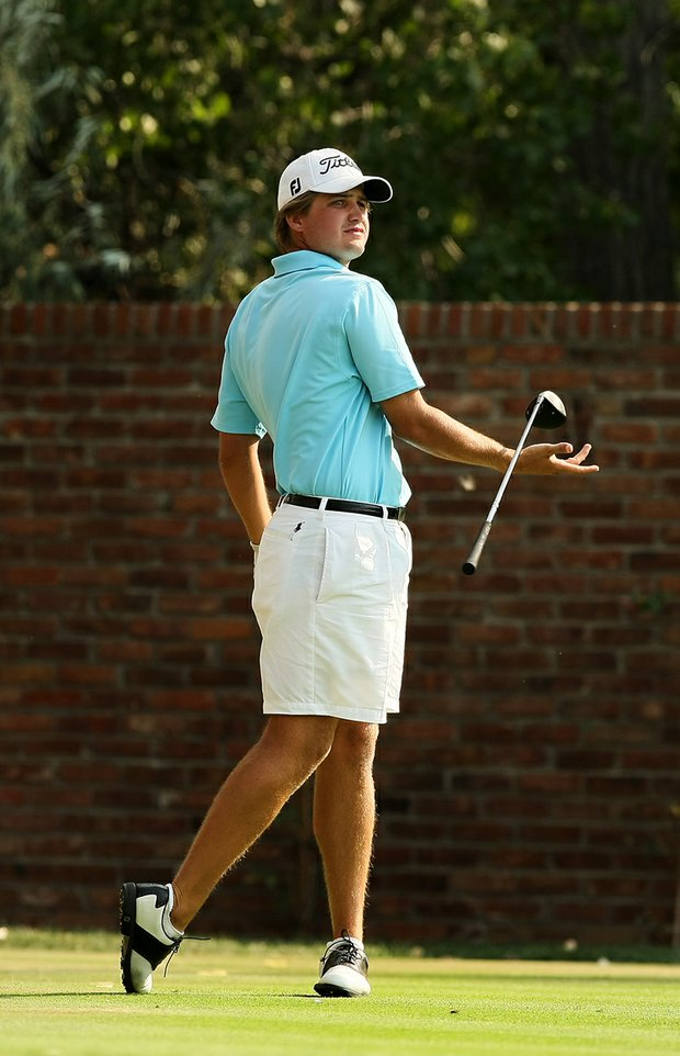 Bobby Wyatt lets go of his club at 18 tee while playing Justin Thomas during the Round of 16 at the 112th U. S. Amateur Championship at Cherry Hills. Wyatt lost to Alabama teammate Justin Thomas.