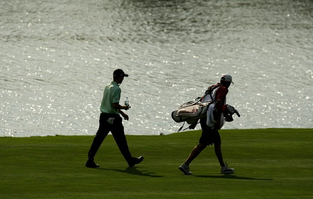 Justin Thomas and his caddie Michael Grellar walk up the fairway at No. 18 during the Round of 16 at the 112th U. S. Amateur Championship at Cherry Hills. Thomas defeated Bobby Wyatt to advance.