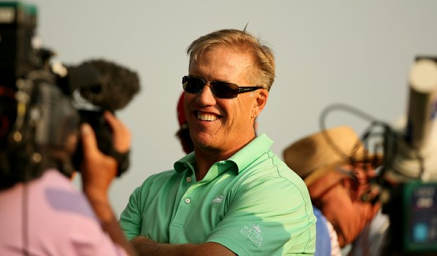 Executive Vice President of Football Operations for the Denver Broncos and former player, John Elway, is interviewed by the Golf Channel during the Round of 16 at the 112th U. S. Amateur Championship at Cherry Hills Country Club.