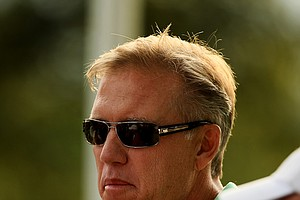 Executive Vice President of Football Operations for the Denver Broncos and former player, John Elway, watches the final match of the day during the Round of 16 at the 112th U. S. Amateur Championship at Cherry Hills Country Club in Colorado.