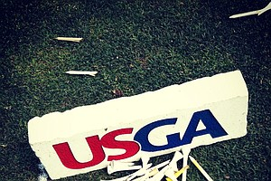 Broken tees lie near a USGA tee marker during the Round of 16 at the 112th U. S. Amateur Championship at Cherry Hills Country Club in Colorado.