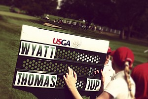 The standard bearer during the Round of 16 at the 112th U. S. Amateur Championship at Cherry Hills Country Club in Colorado.