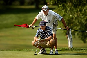 Michael Weaver with father/caddie Bill at No. 14 during the quarterfinals of the 112th U. S. Amateur Championship at Cherry Hills Country Club in Colorado. Weaver will face Justin Thomas in the semifinals.