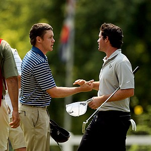 Micheal Weaver, left, shakes hands with Ricardo Gouveia after defeating him during the quarterfinals of the 112th U. S. Amateur Championship at Cherry Hills Country Club in Colorado.