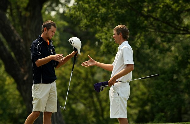 Chris Williams offers his hand to Steven Fox after losing 4&2 during the quarterfinals of the 112th U. S. Amateur Championship at Cherry Hills Country Club in Colorado. Fox will face Brandon Hagy in the semifinals.