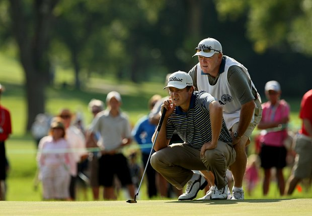 Michael Weaver with his father/caddie Bill during the semifinals of the 112th U. S. Amateur Championship at Cherry Hills Country Club in Cherry Hills Village, Colo.