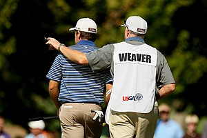 Bill Weaver, right, carried his son, Michael's bag during the 112th U. S. Amateur Championship at Cherry Hills Country Club in Cherry Hills Village, Colo.