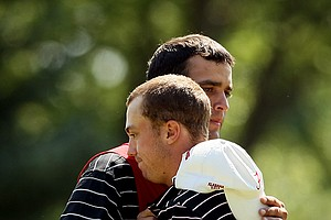 Justin Thomas gets a hug from his caddie Michael Grellar after losing to Michael Weaver during the semifinals of the 112th U. S. Amateur Championship at Cherry Hills Country Club in Cherry Hills Village, Colo.